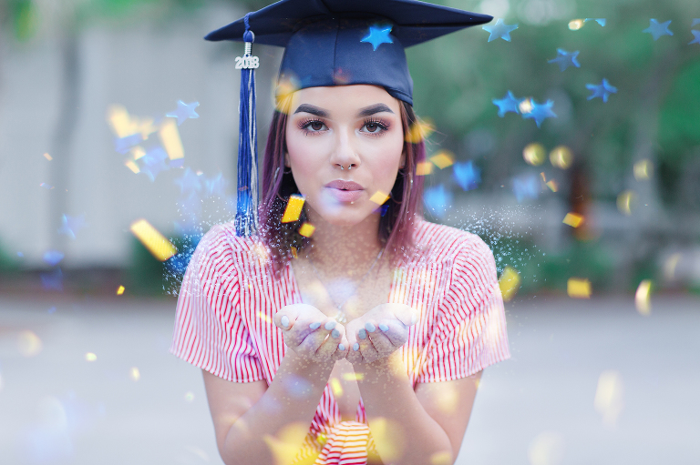 cap and gown senior photo with confetti